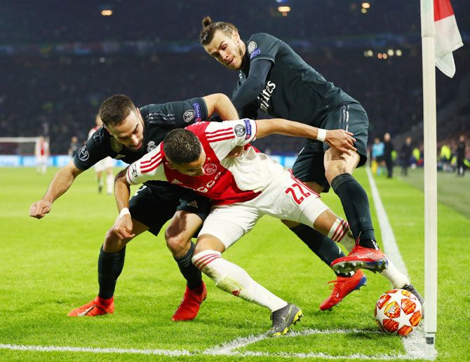 Ajax's Hakim Ziyech is challenged by Real Madrid's Daniel Carvajal and Gareth Bale