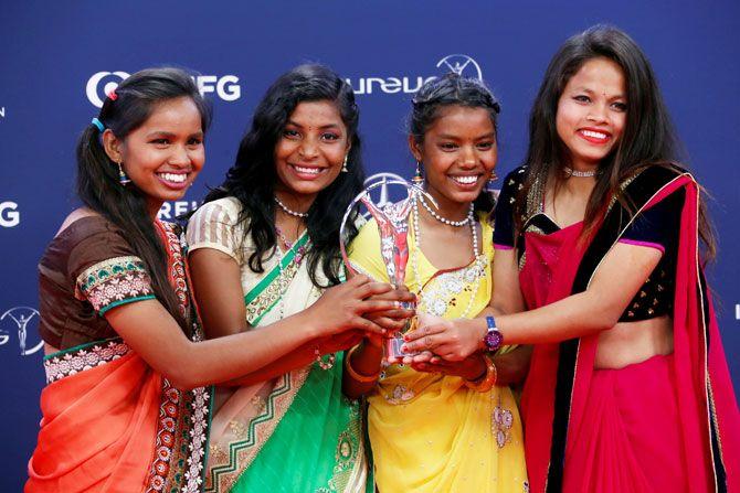 Yuwa-India's Neeta Kumari, Hema Kumari, Konika Kumari, and Radha Kumari pose after winning the Laureus Sport for Good award on Monday