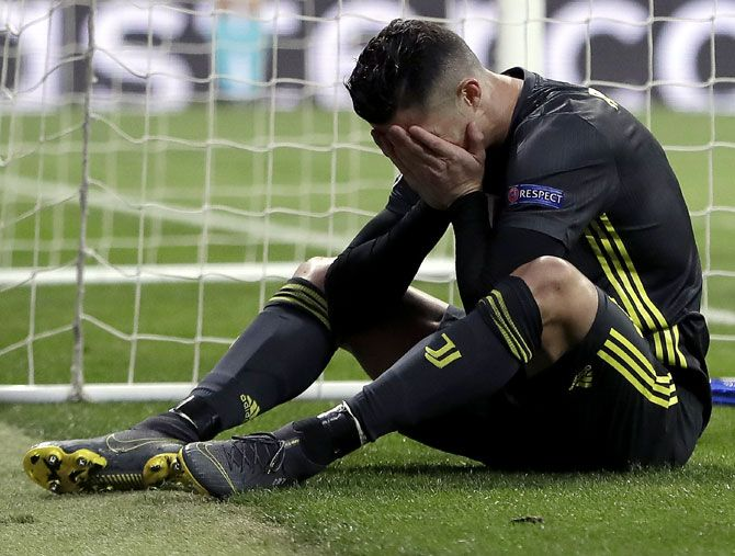 Cristiano Ronaldo reacts after missing a chance during their Champions League last-16 tie against Juventus on Wednesday, February 20