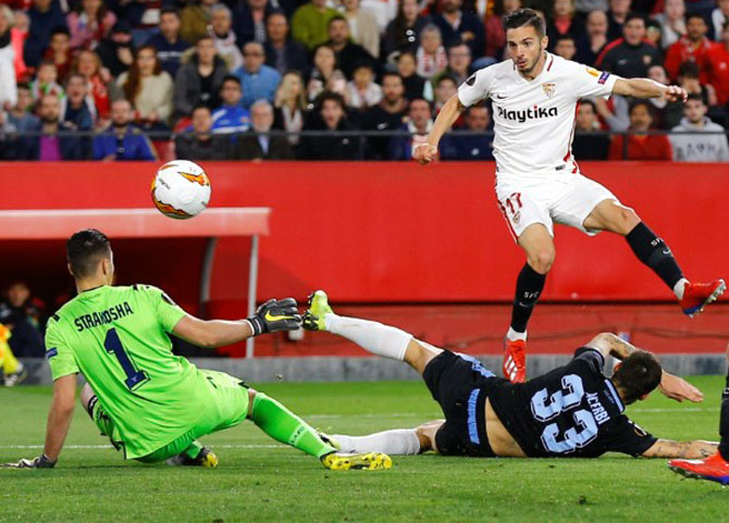 Sevilla's Pablo Sarabia (left) scores their second goal against Lazio in their Champions League Round of 32 match on Wednesday, February 20