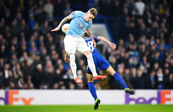 Malmo's Soren Rieks challenges for the ball with Chelsea's Cesar Azpilicueta during their Round of 32 second leg Europa League match at Stamford Bridge in London on Thursday, February 21