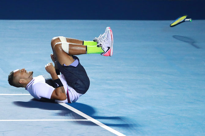 Australia's Nick Kyrgios celebrates after winning his match against Spain's Rafael Nadal on Day 3 of the Telcel Mexican Open at Mextenis Stadium in Acapulco, Mexico, on Wednesday