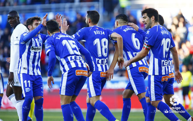 Deportivo Alaves players celebrate after scoring against Valencia on Saturday