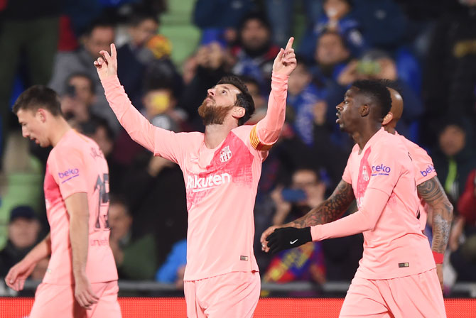 FC Barcelona's Lionel Messi celebrates after scoring his team's opening goal against Getafe CF durng their La Liga match at Coliseum Alfonso Perez in Getafe, Spain, on Sunday