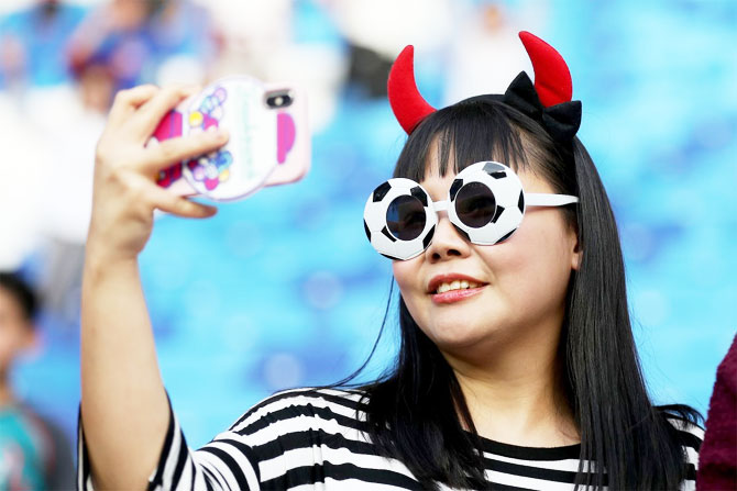 A South Korea fans clicks a selfie