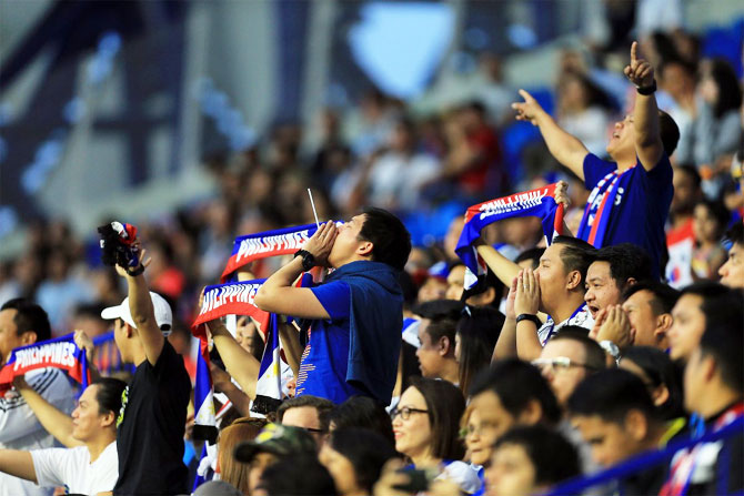 A group of Philippines fans egg their team on as they doggedly defended in their 1-0 loss against South Korea