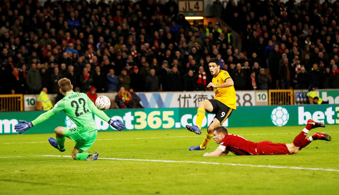 Wolverhampton Wanderers' Raul Jimenez scores their openning goal against Liverpool
