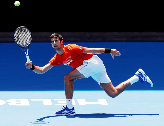 Serbia's Novak Djokovic at a practice match against Britain's Andy Murray at Melbourne Park in Melbourne on Thursday