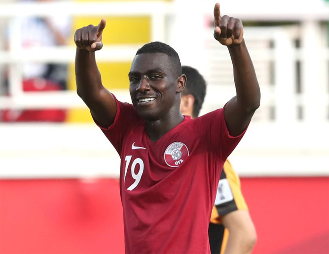 Qatar's Almoez Ali celebrates after scoring against North Korea on Sunday