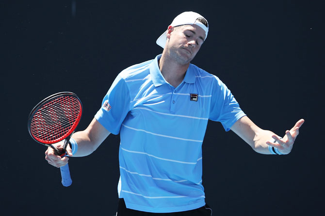 USA's John Isner did have answers to compatriot Reilly Opelka in their first round match