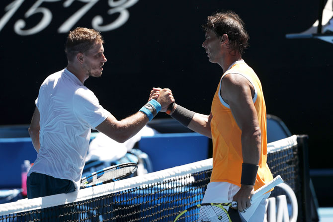 Spain's Rafael Nadal is congratulated by Australia's James Duckworth after winning the match