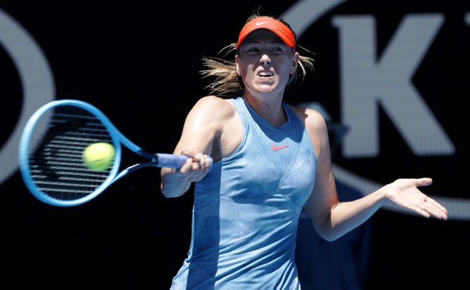 Maria Sharapova plays a return during her match against Harriet Bart