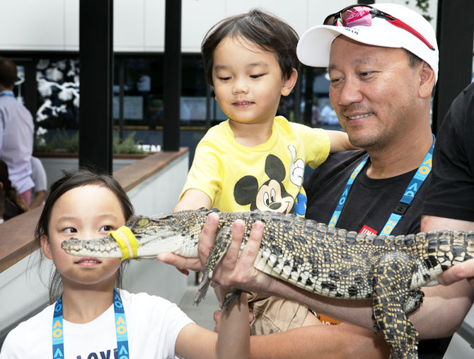 Former player Michael Chang and his children meet a crocodile