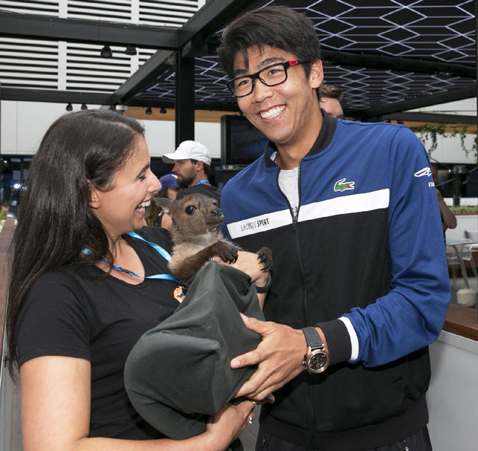South Korea's Hyeon Chung meets a kangaroo joey