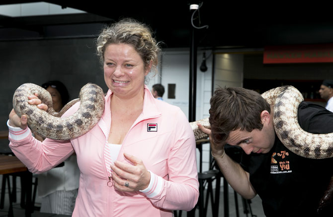 Kin Clijsters would like us to believe she is comfortable with that snake around her neck