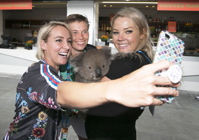 USA's Bethanie Mattek-Sands takes a selfie with her mixed doubles partner Dutchman Demi Schuurs and a koala