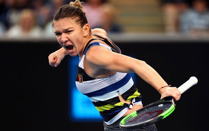 Simona Halep celebrates winning a point in her third round match against Venus Williams on Saturday