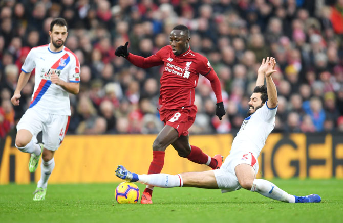 Liverpool's Naby Keita is challenged by Crystal Palace's James Tomkins
