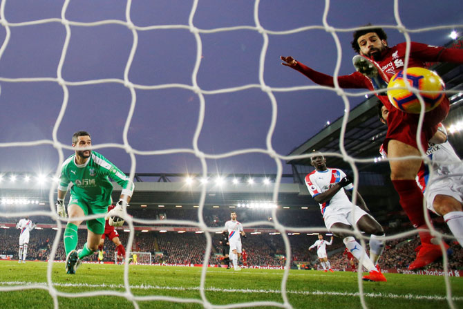 Liverpool's Mohamed Salah scores their third goal against Crystal Palace at Anfield