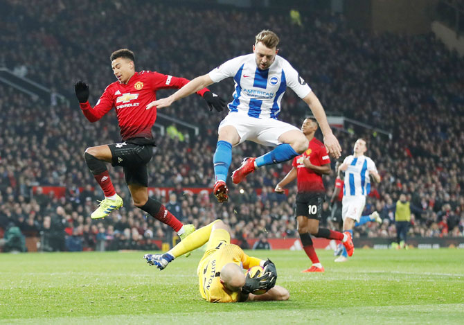 Manchester United's Jesse Lingard in action with Brighton's David Button