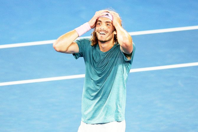 Greece's Stefanos Tsitsipas celebrates after defeating Roger Federer in the fourth round on Sunday, January 20