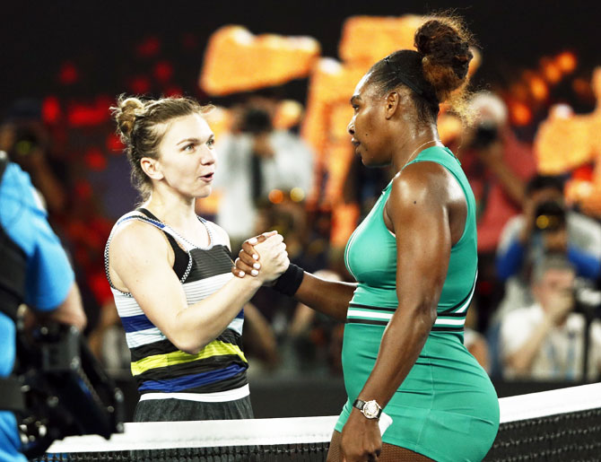 USA's Serena Williams is congratulated by Romania's Simona Halep after their fourth round match