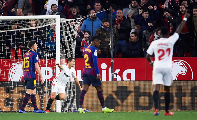 Sevilla FC's Wissam Ben Yedder celebrates after scoring his team's second goal against FC Barcelona during the Copa del first leg quarter-final match at Estadio Ramon Sanchez Pizjuan in Seville, on Wednesday.
