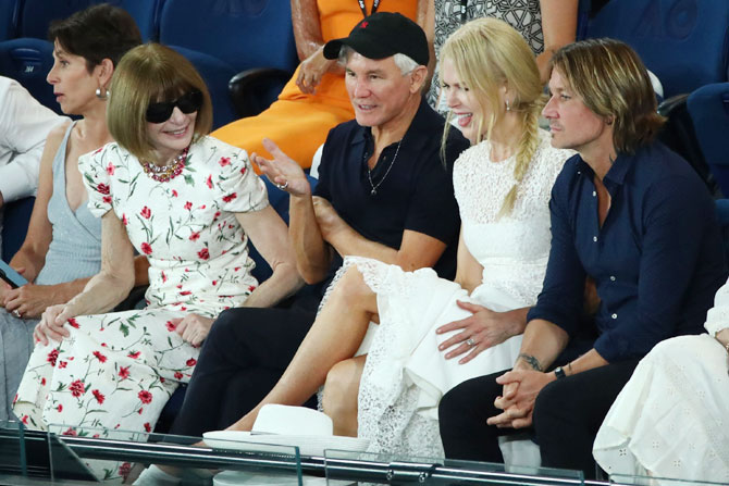 Anna Wintour, editor-in-chief of Vogue magazine chats with Baz Luhrmann, Nicole Kidman and Keith Urban on Thursday