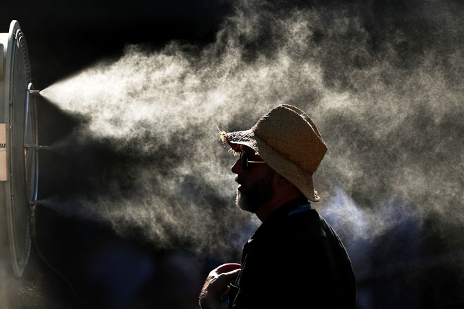 Fans cool off in the hot conditions during day 11 of the 2019 Australian Open at Melbourne Park on January 24, 2019 in Melbourne, Australia
