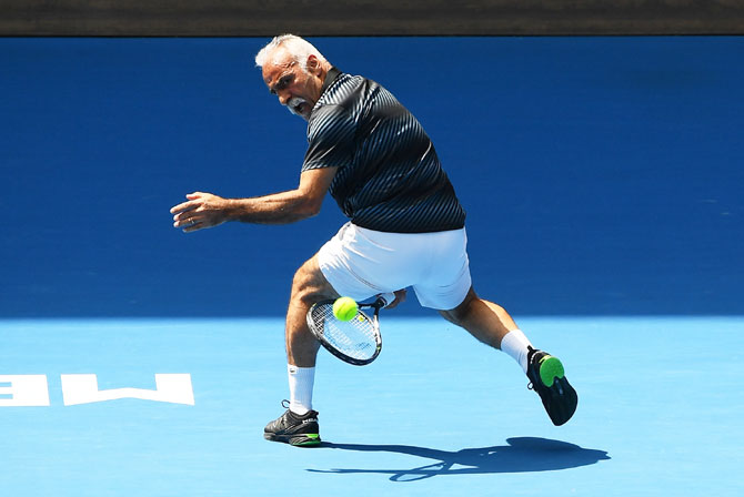 France's Mansour Bahrami plays a ''tweener' during the men's legends doubles final against Mark Philippoussis Jonas Bjorkman and Thomas Johansson of Sweden on Thursday, January 25