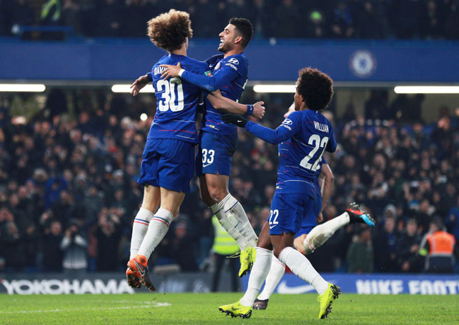 Chelsea's David Luiz, Willian and Emerson Palmieri celebrate winning the match after the penalty shootout against Tottenham in the League Cup Semi-Final Second Leg at Stamford Bridge on Thursday