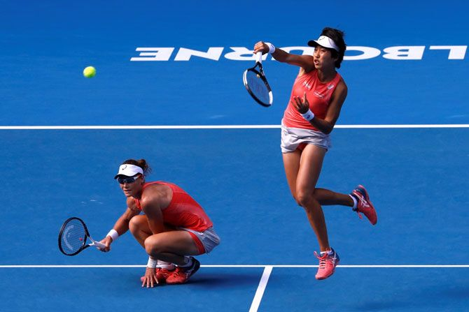 Australia's Samantha Stosur and China's Shuai Zhang in action during their match against Hungary's Timea Babos and France's Kristina Mladenovic