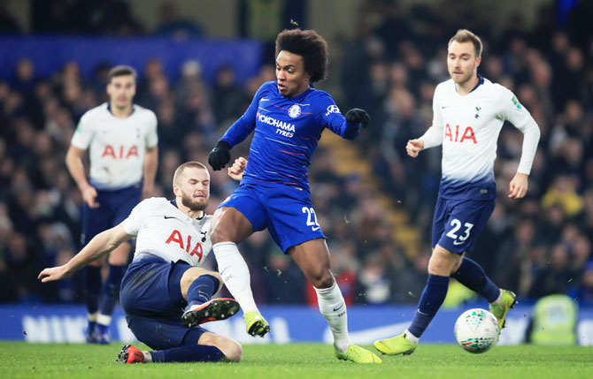 Chelsea's Willian is tackled by Tottenham Hotspu's Eric Dier