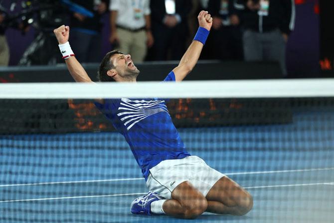 Serbia's Novak Djokovic celebrates after winning championship point