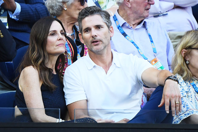 Hollywood's Australian actor Eric Bana and his wife Rebecca Gleeson watch the men's semi-final between Serbia's Novak Djokovic and France's Lucas Pouille on Friday