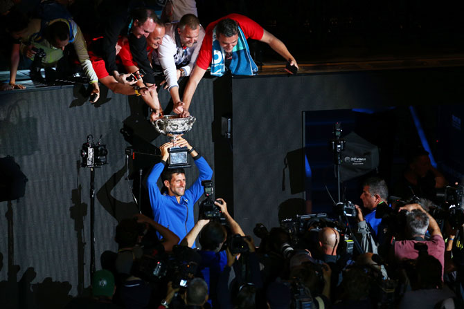 Novak Djokovic celebrates with Serbian fans following his Australian Open victory against Spain's Rafael Nadal on Sunday