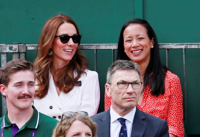 Britain's Catherine, Duchess of Cambridge, sits alongside Anne Keothavong during the first round match between Britain's Harriet Dart and Christina McHale of the United States.