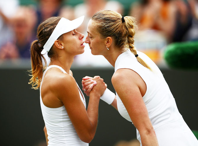 Czech Republic's Petra Kvitova and Poland's Magda Linette greet each other at the net after their third round match
