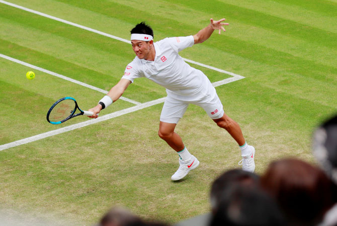 Japan's Kei Nishikori in action during his third round match against USA's Steve Johnson