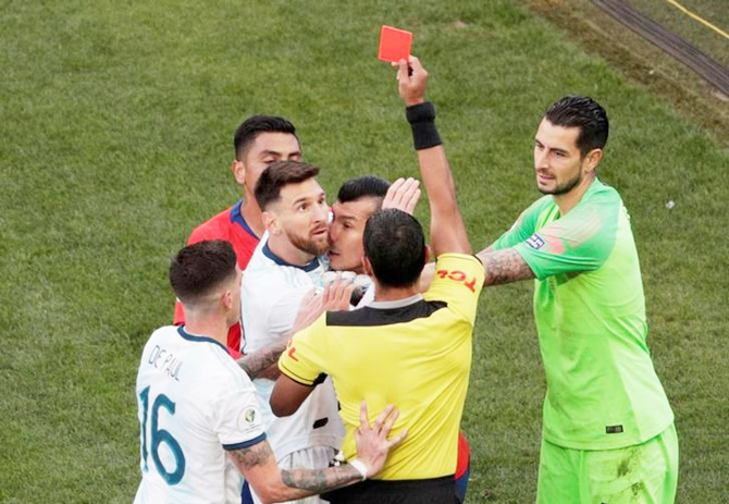 Chile's Gary Medel and Argentina's Lionel Messi are shown the red card by referee Mario Diaz de Vivar during the Copa America third place play-off