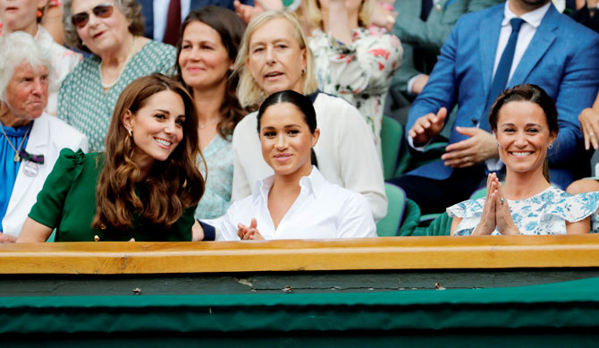 Britain's Catherine, Duchess of Cambridge, with Meghan, Duchess of Sussex, and Pippa Middleton in the Royal Box ahead of the final between Serena Williams and Simona Halep