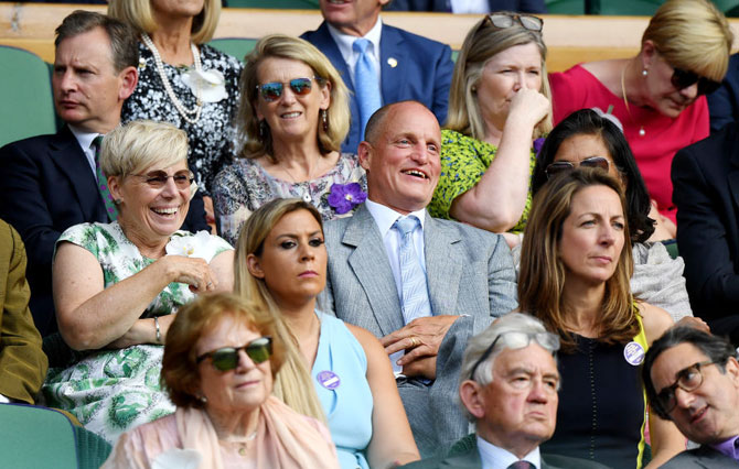 Actor Woody Harrelson enjoys the action from the Royal Box