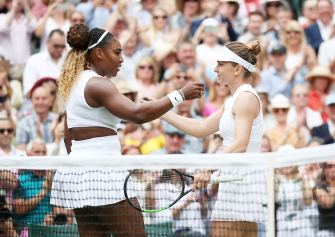 Romania's Simona Halep and Serena Williams of the United States embrace after the women's singles final at Wimbledon.