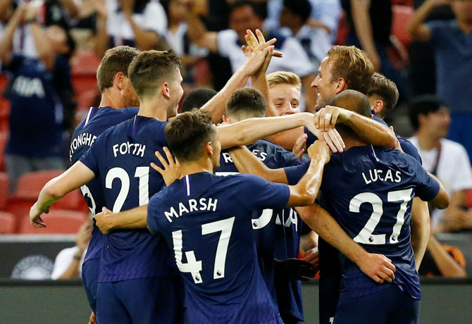 Tottenham's Harry Kane celebrates with teammates on scoring their third goal against Juventus in the International Champions Cup at Singapore National Stadium in Singapore on Sunday