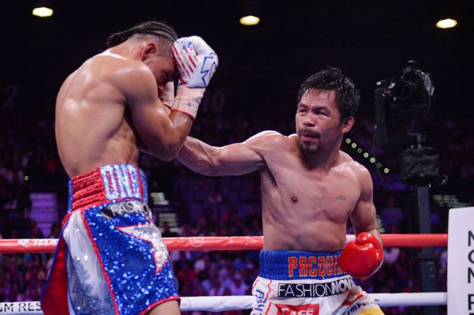 Manny Pacquiao (white trunks) and Keith Thurman exchange punches during their WBA welterweight championship bout at MGM Grand Garden Arena in Las Vegas, Nevada on Saturday. Pacquiao won via split decision