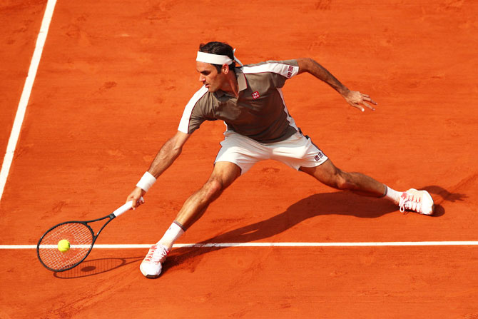 Switzerland's Roger Federer returns during his men's singles quarter-final against compatriot Stan Wawrinka on Tuesday.