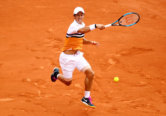 Japan's Kei Nishikori plays a forehand return