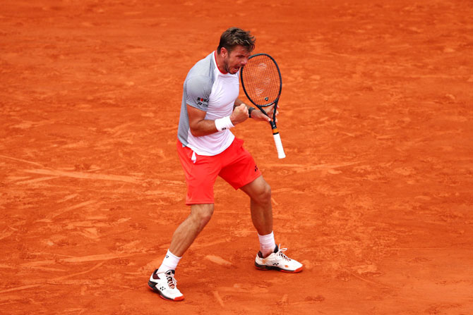 Stan Wawrinka celebrates a point during her match against Roger Federer