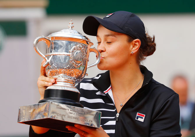 Australia's Ashleigh Barty celebrates with the trophy after winning the women's French Open final against Czech Republic's Marketa Vondrousova on Saturday