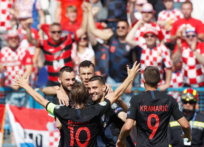 Croat players celebrate their goal against Wales during the 2020 UEFA European Championships Group E qualifying match at Stadium Gradski Vrt in Osijek, Croatia, on Saturday